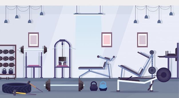 Lo studio del club di salute del crossfit con il concetto sano di stile di vita dell'attrezzatura di allenamento non svuota l'apparecchiatura di addestramento interna della palestra orizzontale