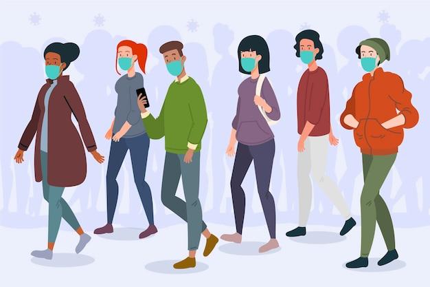 Folla di persone che indossano maschere per il viso