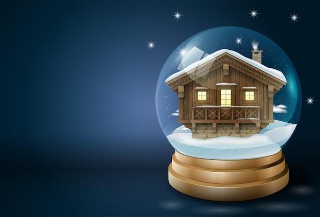 Sfera di natale in cristallo con una casa. regalo di festa. lampada decorativa di capodanno