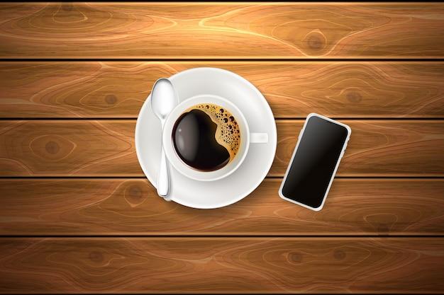 Tazza di caffè cucchiaio struttura in legno smartphone