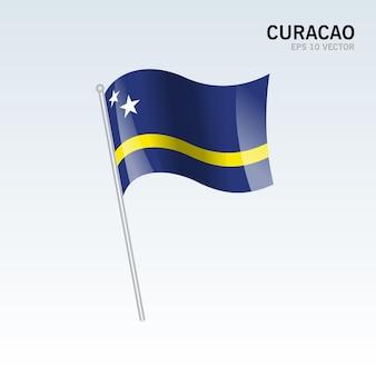Curacao sventolando bandiera isolata su gray
