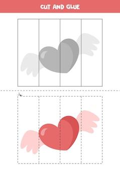 Taglia e incolla il cuore con le ali. foglio di lavoro per la pratica del taglio.