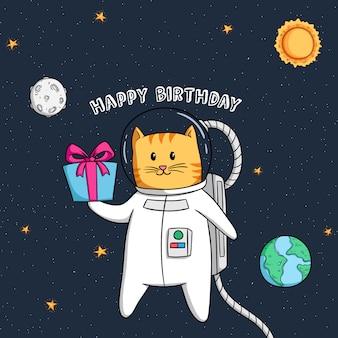 Gatto sveglio dell'astronauta che vola nello spazio che tiene il contenitore di regalo per il compleanno