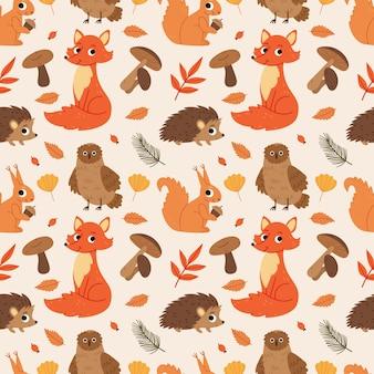 Simpatico motivo autunnale con animali della foresta volpe gufo scoiattolo funghi foglie riccio