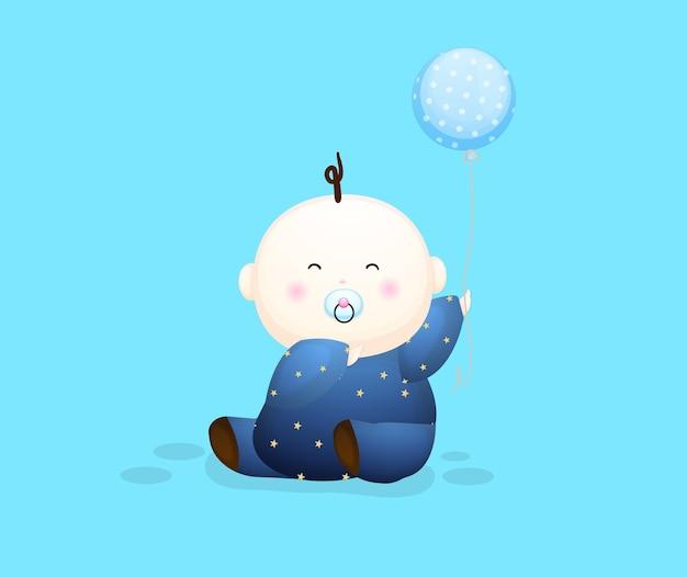 Neonato sveglio che tiene un personaggio dei cartoni animati dell'aerostato. illustrazione del concetto di bambino vettore premium