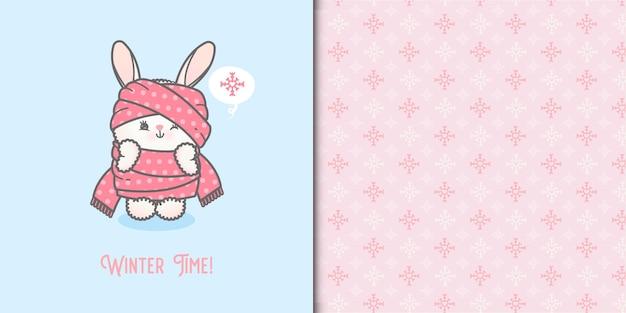 Coniglietto sveglio del bambino arrotolato in un modello senza cuciture di fiocchi di neve e sciarpa