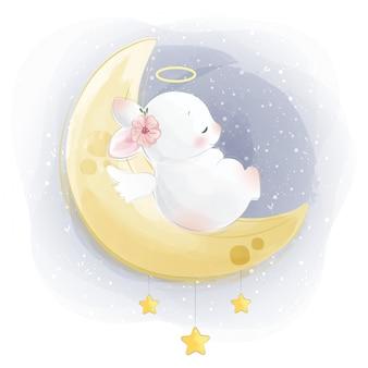 Cute baby bunny sleeping on moon