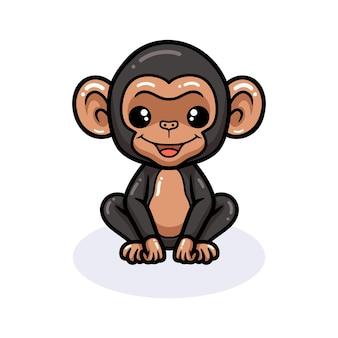 Simpatico cartone animato di scimpanzé bambino seduto