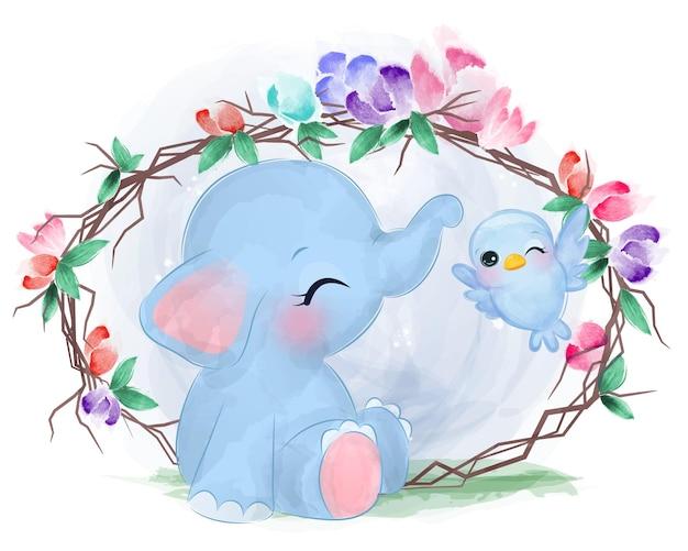 Elefante sveglio del bambino che gioca con l'uccello