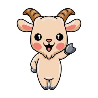 Cartone animato carino capra agitando la mano