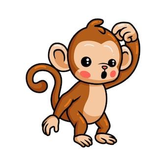 Simpatico cartone animato scimmia bambino confuso