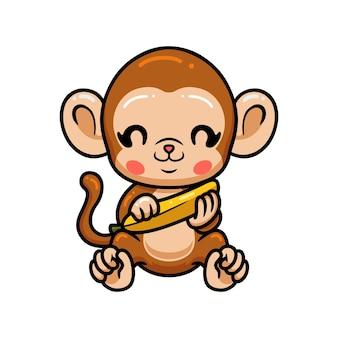 Simpatico cartone animato scimmia bambino seduto con banana