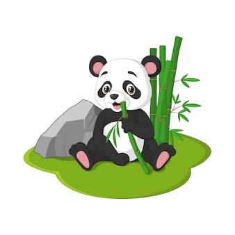 Panda sveglio del bambino che si siede con mangiare steli di bambù