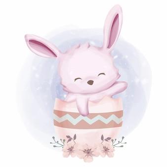 Coniglio sveglio del bambino con la tazza