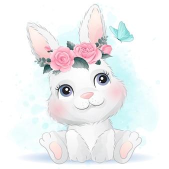 Simpatico coniglio bambino con fiori