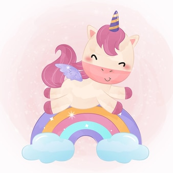 Unicorno sveglio del bambino che gioca con l'arcobaleno
