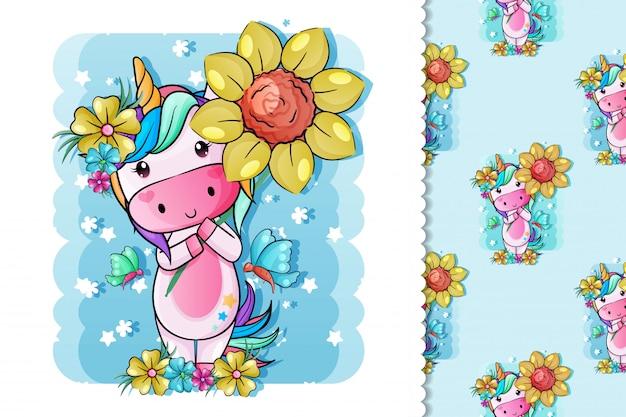 Unicorno sveglio del bambino con i fiori