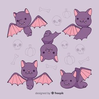 Simpatici pipistrelli con ossa in background Vettore Premium