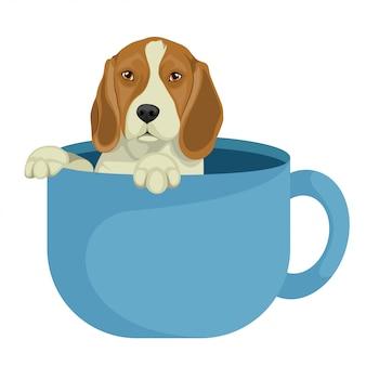 Cane da lepre sveglio che si siede in tazza da caffè
