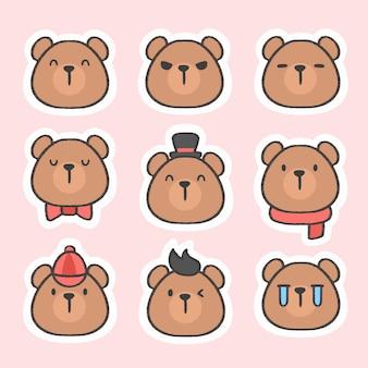 Raccolta disegnata a mano del fumetto dell'autoadesivo sveglio dell'emoticon dell'orso Vettore Premium