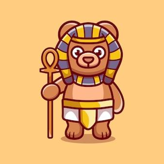 Simpatico orso faraone che porta un bastone
