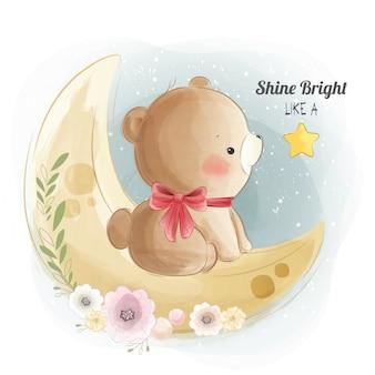 Orso carino seduto sulla luna