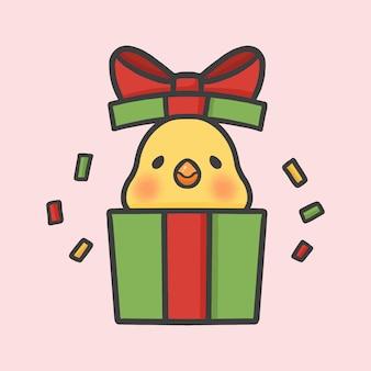 Uccello sveglio nel fumetto disegnato a mano di natale di sorpresa del contenitore di regalo
