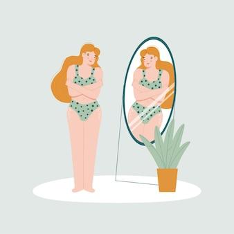 Carina bionda in biancheria intima si guarda allo specchio si abbraccia e sorride.