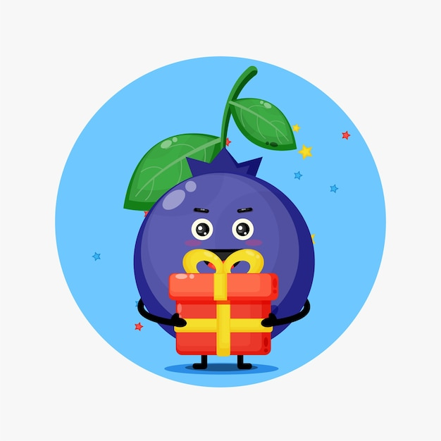 Simpatica mascotte di mirtilli porta una confezione regalo