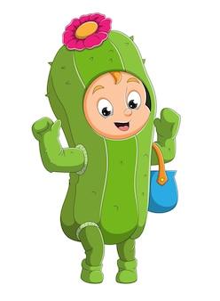 Il ragazzo carino sta celebrando l'halloween con il costume da cactus dell'illustrazione