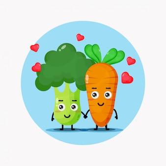 Carino broccoli e carote che tengono le mani