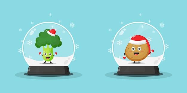 Simpatica mascotte di broccoli e patate su un globo di neve