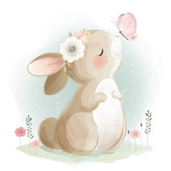 Simpatico coniglietto e la farfalla