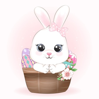 Illustrazione sveglia del coniglietto e delle uova nel cestino