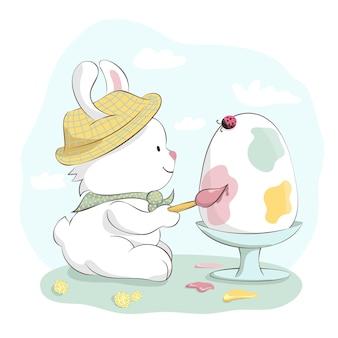 Simpatico coniglietto con cappello che dipinge l'uovo di pasqua. illustrazione disegnata a mano del fumetto