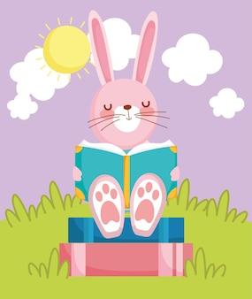 Simpatico coniglietto che legge la scuola di libri