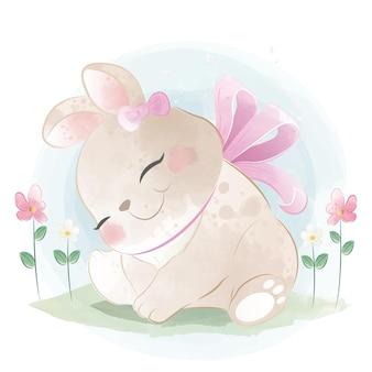 Simpatico coniglietto e fiori di tulipano