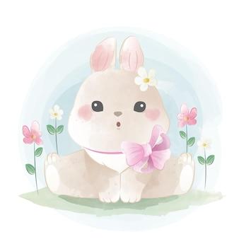 Simpatico coniglietto che indossa una sciarpa con fiocco