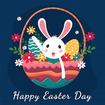 Simpatico coniglietto con uova stampate e fiori nel cestino colorato su blu, carta di buona pasqua