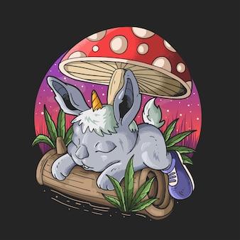 Simpatico coniglietto con corno di unicorno che giace sotto un disegno di illustrazione di un fumetto di funghi su sfondo nero