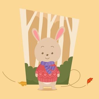 Coniglietto simpatico cartone animato che indossa un maglione nella foresta