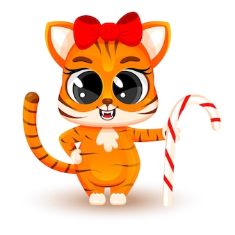Cucciolo di tigre sveglio del fumetto con il bastoncino di zucchero. concetto di natale, capodanno cinese, simbolo del 2022. adesivo alla moda. biglietto natalizio. illustrazione vettoriale isolato su sfondo bianco.