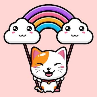 Simpatico gatto sta giocando sull'altalena
