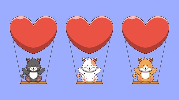 Il simpatico gatto è seduto sull'altalena dell'amore