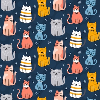 Modello di gatti carino su sfondo blu scuro