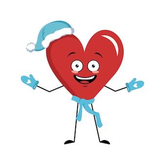 Simpatico personaggio cuore rosso con ali ed emozioni gioiose, viso, occhi felici, braccia e gambe. decorazione festiva per san valentino. felice anno nuovo simbolo d'amore in un cappello rosso di babbo natale, sciarpa e guanti