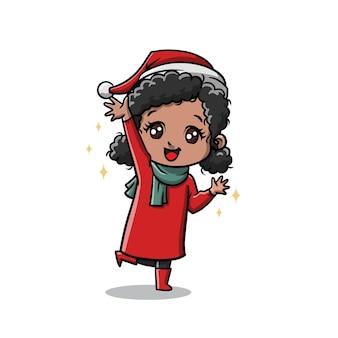 La ragazza carina dei bambini festeggia il cartone animato di natale
