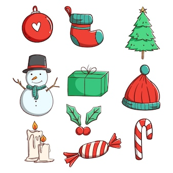 Simpatici elementi natalizi per la decorazione con stile disegnato a mano o doodle