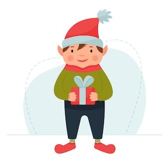 Simpatico elfo di natale che tiene un regalo gnomo in un berretto rosso con regalo