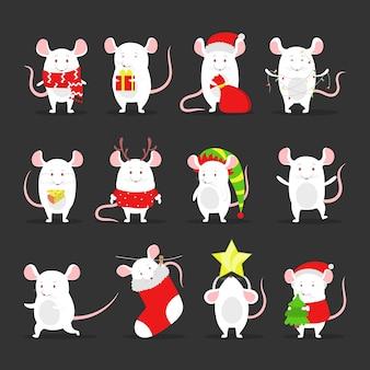 Insieme sveglio del ratto di natale che tiene roba festiva.